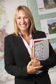 stock photo of real-estate agent  - Portrait Of Female Estate Agent In Office - JPG