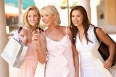 stock photo of mother daughter  - Senior Mother And Daughters Enjoying Shopping Trip Together - JPG