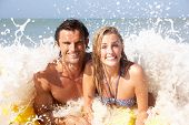 image of beach holiday  - Young couple on beach holiday - JPG