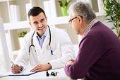 Doctor Explaining Prescription To Senior Patient poster