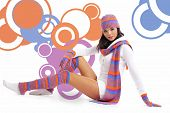 Winter fashion girl  over abstract round modern design background