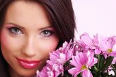 stock photo of young woman posing the camera  - Attractive young woman face with flowers - JPG
