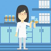 Постер, плакат: An asian female scientist holding a test tube with biohazard sign Scientist examining a test tube i