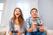 Portrait Of Happy Excited Family Playing Video Games poster
