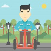 Постер, плакат: An asian young man driving electric scooter Man on self balancing electric scooter with two wheels