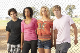 image of male female  - Diverse Group Of Teenagers Standing In Playground - JPG