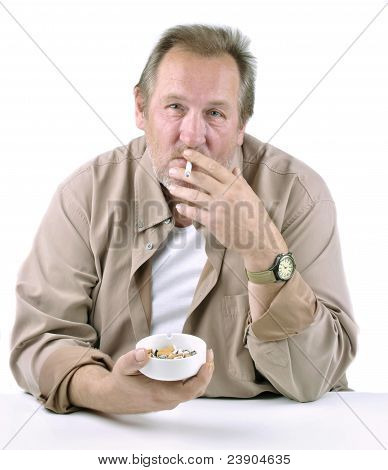 Horrified Man In His 50S Sitting At A Table With A Cigarette And Ashtray