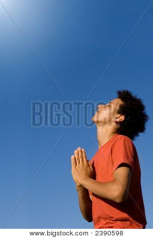 Happy Christian Youth Praying