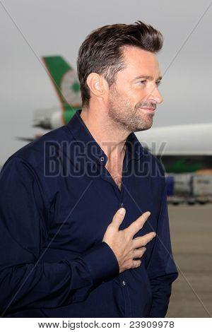 LOS ANGELES - SEPT 23:  Hugh Jackman arrives as Virgin America unveils new DreamWorks 'Reel Steel' plane at LAX Airport on September 23, 2011 in Los Angeles, CA