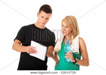 A picture of a young couple discussing workout plan over white background
