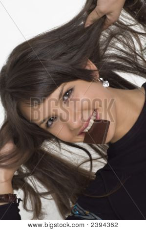Pretty Young Woman Eating A Chocolate