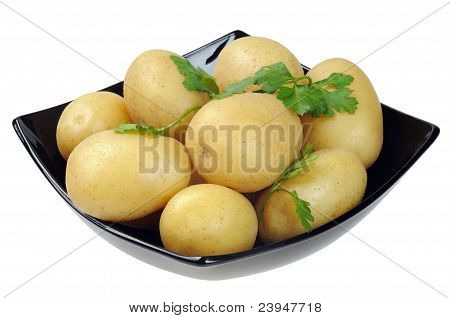 Dish with boiled potatoes in their skins