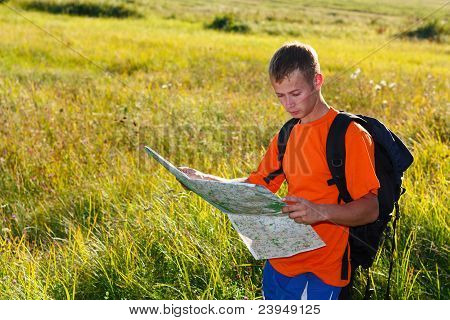 Man Traveler With Map In Hand