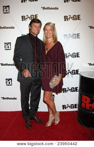 LOS ANGELES - SEPT 30:  Grant Show, Katherine LaNasa arriving at  the RAGE Game Launch at the Chinatown's Historical Central Plaza on September 30, 2011 in Los Angeles, CA