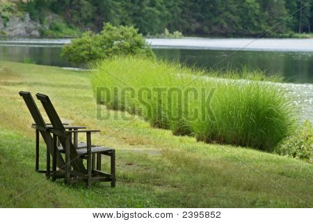 Two Chairs Facing The Lake