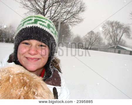 Girl With Dog In The Snow