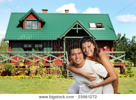 A picture of a happy young couple outside their new country  house