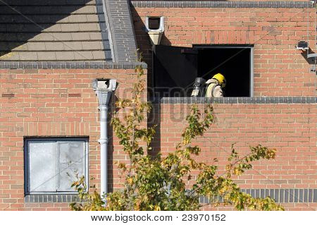 Firefighter Entering A Smoke Filled Building