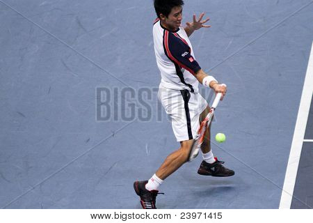 BUKIT JALIL, MALAYSIA- OCT 01:Japan's Kei Nishikori hits a forehand return in this Malaysian Open semi-final match against Serbia's Janko Tipsarevic on October 01, 2011 in Putra Stadium, Bukit Jalil, Malaysia.
