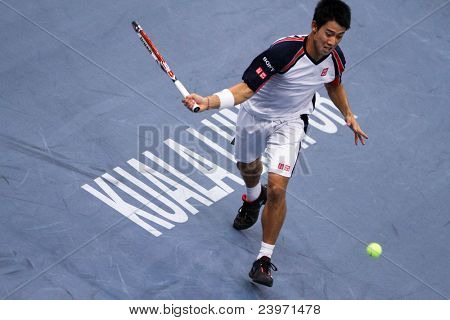 BUKIT JALIL, MALAYSIA- OCT 01: Japan's Kei Nishikori attempts a return in this Malaysian Open semi-final match against Serbia's Janko Tipsarevic on October 01, 2011 in Putra Stadium, Bukit Jalil, Malaysia.