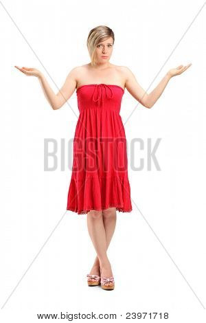 Full length portrait of a woman gesturing don't know isolated on white background