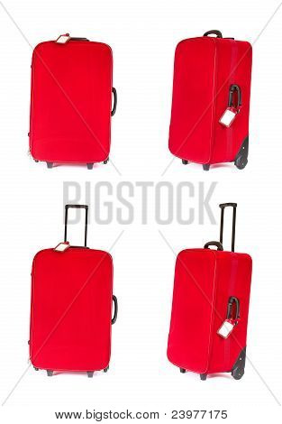 Red Suitcase With Blank Identification Tag Over White. Set Of Four Suitcases In Different Angle View
