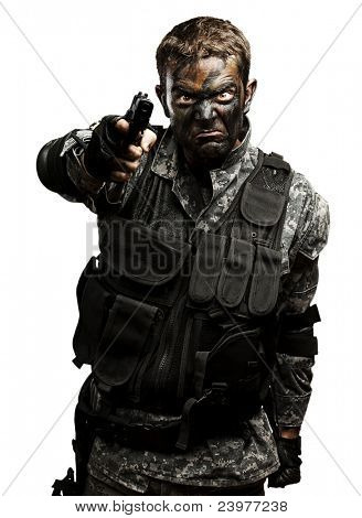 portrait of furious soldier with urban camouflage pointing with gun over white background