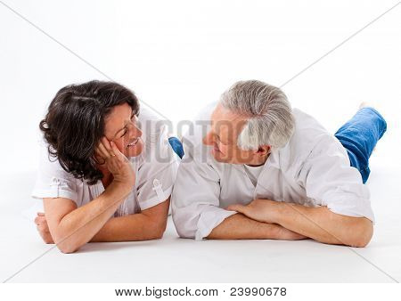 sweet senior couple on the floor with white background