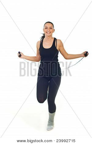 Cheerful Woman Leaping Jump Rope