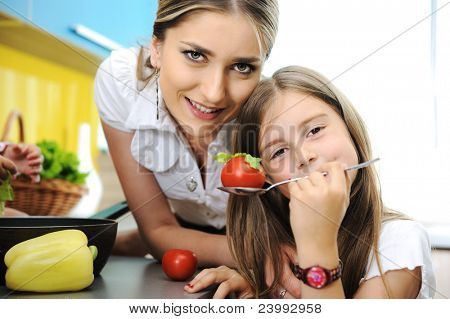 Mother and daughter cooking, love and work together