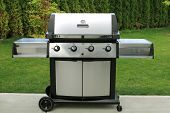 stock photo of brazier  - stainless barbecue grill as a outdoor appliance - JPG
