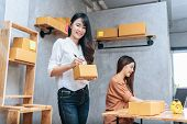 Two Young Asian Women Startup Small Business Entrepreneur Sme Distribution Warehouse With Parcel Mai poster