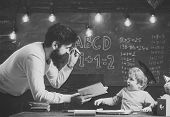 Wunderkind And Genius Concept. Father, Teacher Reading Book, Teaching Kid, Son, Chalkboard On Backgr poster