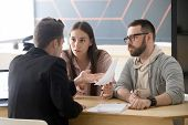 Angry Millennial Couple Complaining Having Claims About Bad Contract Terms Disputing At Meeting With poster