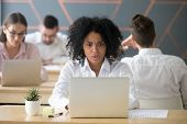 Shocked African Woman Looking At Laptop In Shared Office, Stressed Black Female Employee Terrified R poster