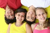 stock photo of close-up shot  - happy smiling beautiful teens close up of beautiful faces and smiles - JPG