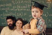 Support Concept. Kid Holds Teddy Bear And Performing. Parents Listening Their Son, Chalkboard On Bac poster