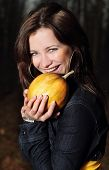 Smiling Girl With Pumpkin