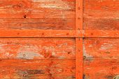 Old Grunge Wooden Orange Background Door Detail With Metal Rivets poster