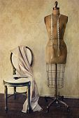 stock photo of dress mannequin  - Antique dress form and chair with vintage look - JPG