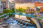 Greenville, South Carolina, USA downtown cityscape on the Reedy River at dusk. poster