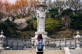 Постер, плакат: Young Asian Traveler Traveling Into Bongeunsa Temple In The Gangnam District Of Seoul South Korea