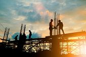 Silhouette Of Engineer And Construction Team Working At Site Over Blurred Background Sunset Pastel F poster