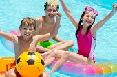 stock photo of swimming pool family  - Children playing in pool - JPG