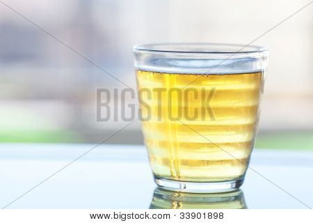 Beer In A Glass On The Reflective Surface