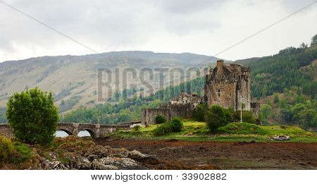 Eilean Donan castle on a cloudy day.    low tide. Scotland