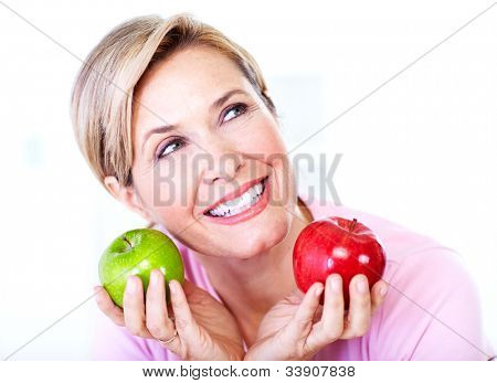 Senior woman with apple. Diet. Healthy lifestyle.