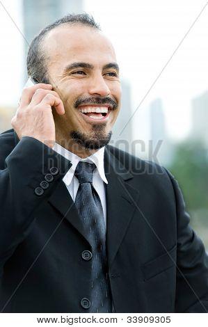 Smiling Hispanic Businessman On Phone