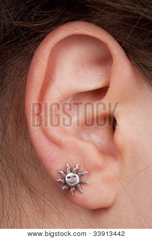 Women's Ear With An Earring
