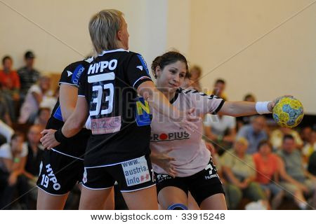 SIOFOK, HUNGARY - AUGUST 24: Unidentified players in action at a Siofok Cup handball game Siofok KC pink (HUN) vs. HYPO NO blue (AUT) August 24, 2008 in Siofok, Hungary.